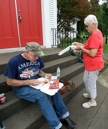 Jim and Hattie McIlvaine, of Neosho, enjoy the fare at the 6th Annual Big Spring Bluegrass & BBQ on Saturday at Neosho's Big Spring Park. The event featured seven bands and a bounty of food vendors to enjoy.<br /> Globe | Laurie SIsk