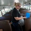 Sandy Scheurich, director of central service at Freeman Health System, volunteers with Neosho Bright Futures Stuff the Bus event on Friday at the Neosho Walmart. The event will be accepting school supplies at various locations over the next couple of weeks.<br /> Globe | Roger Nomer
