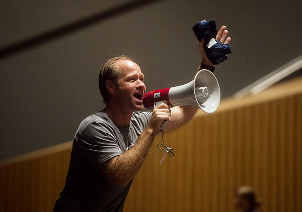 Adam Colin, North Middle School teacher, fires up the crowd during Monday's back-to-school rally at Joplin High School.<br /> Globe | Roger Nomer
