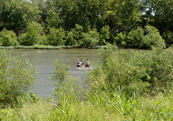 Researchers collect samples along Spring River in Baxter Springs on Thursday.<br /> Globe   Roger Nomer