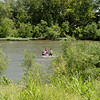 Researchers collect samples along Spring River in Baxter Springs on Thursday.<br /> Globe | Roger Nomer