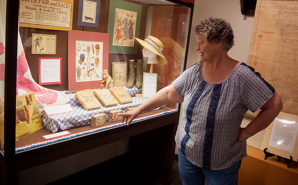 Michele Hansford talks about toys from the Hyde House, which is listed on a new digital history map of Carthage, during an interview on Wednesday at the Powers Museum.<br /> Globe | Roger Nomer