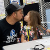 Daniel Beal gives a goodbye kiss to his daughter Mariah before her first day of kindergarten at Cecil Floyd Elementary on Thursday.<br /> Globe | Roger Nomer