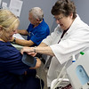 Steve Weston and Yvonne Kelly check in Sandy Conlee to the Joplin Community Clinic on Thursday.<br /> Globe | Roger Nomer