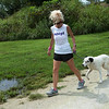 Kelly Johnson walks with Riley at an outdoor track at the Joplin Humane Society on Monday.<br /> Globe | Roger Nomer
