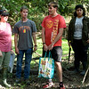 """From the left: Pittsburg State professor Christine Brodsky and students Caleb Durbin, Brady Taylor and Ximena Bogarin scout out areas to place """"camera traps"""" on Thursday near Pittsburg. The group is part of a 50-state Smithsonian snapshot program intended to identify which specific mammals live in what areas."""