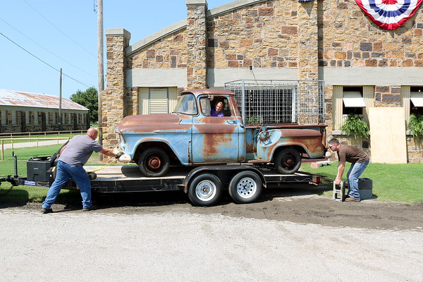 Mike Fidler (left) helps Kelli and Russell Fent unload the 1956 Chevy Truck once used as the Wyandotte FFA truck when Ramon Fent was the ag teacher. The truck is part of a Wyandotte FFA historical display at the 2019 Ottawa County Free Fair.  Kaylea M. Hutson-Miller | Globe