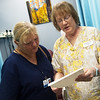 Linda Flory, right, goes over the results of Sandy Conlee's pulminary function test with her on Thursday at the Joplin Community Clinic.<br /> Globe | Roger Nomer