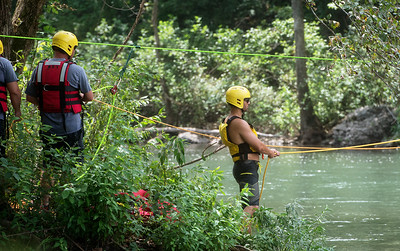 Members of the Joplin Fire Department practice swift water rescue training at Shoal Creek on Wednesday afternoon. Globe | Roger Nomer