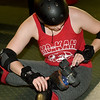 "Hannah Whitney, aka ""Sugar Rush""  adjusts her skates during practice for the Mo-Kan Roller Girlz on Thursday night at Spinning Wheels SK8 Center in Carl Junction.<br /> Globe 