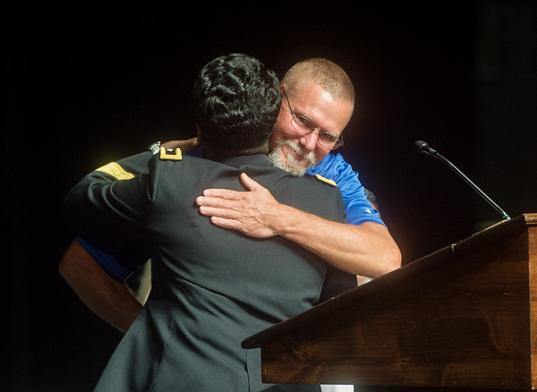 Major Gen. Donna Martin awards Lorin Curtis with a coin of excellence during Monday's back-to-school rally at Joplin High School.<br /> Globe | Roger Nomer