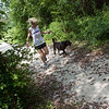 Kellly Johnson runs with Eli at an outdoor track at the Joplin Humane Society on Monday.<br /> Globe | Roger Nomer
