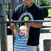Zane Chiles assists his two-year-old son, Blake Chiles as he atempts a chin up on Wednesday at Cunningham Park.<br /> Globe | Laurie Sisk