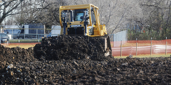 Globe/Roger Nomer<br /> A bulldozer moves dirt for a road at King Jack Park on Tuesday morning.