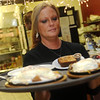 Globe/Roger Nomer<br /> Charmaine McCrary serves lunch at Norma's Kitchen in Webb City on Wednesday.