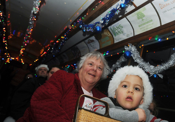Globe/Roger Nomer<br /> Marilyn Clark, Webb City, and her grandson Thomas Conatser, 2, visiting from Cape Carteret, N.C., watch Christmas lights aboard the Polar Bear Express on Saturday evening.  The annual rail trip through King Jack Park ended its run for the season on Saturday.