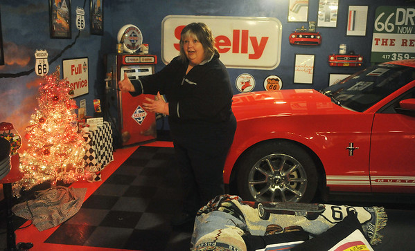 Globe/Roger Nomer<br /> Babs Tims talks about her car-themed tree for her Ford Mustang in her garage.