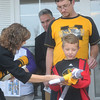 Globe/Roger Nomer<br /> Sarah Reesman, University of Missouri executive associate athletic director, hands Dalton Fickle, 7, a MU sock monkey during Friday's Habitat dedication.