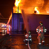 Globe/Joe Hadsall<br /> Joplin firefighters attack a blaze from the backside of a building at 16th and Main Streets on Tuesday evening.