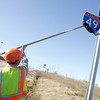 Globe/Roger Nomer<br /> Lonnie Jordan, with MODOT, reveals the new I-49 sign along FF Highway on Wednesday afternoon.