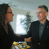 Globe/Roger Nomer<br /> Mike Alden, University of Missouri athletic director, congratulates Christine Taylor on her family's new home following Friday's dedication.