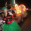Globe/Roger Nomer<br /> Dressed as an elf, Sabrina Purkey waves to the crowd as she walks with the 2 Friends & Junk float in the Christmas Parade on Tuesday.