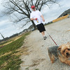 Globe/Roger Nomer<br /> Randal Roberts, Webb City, takes his dog Spoof for a walk along the duck pond in King Jack Park on Monday morning.