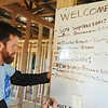 Globe/Roger Nomer<br /> Zach Bozeman, St. Louis, with Americorp, updates a task board at a home on east 18th Street on Thursday morning.