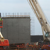Globe/Roger Nomer<br /> Workers put up walls at the site of East Middle School on Monday morning.