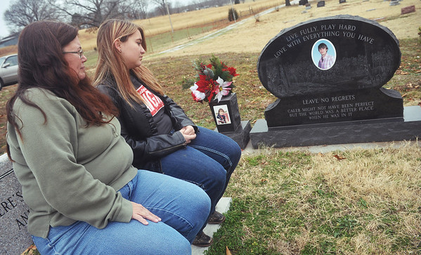 Globe/Roger Nomer<br /> Hannah, 18, and Carmen Kuhn visit the gravesite of their brother and son Caleb Kuhn at Kirk Cemetery on the fifth anniversary of his death on Wednesday.
