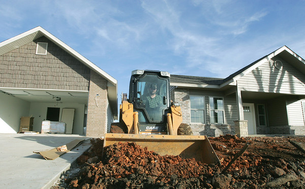 Globe/Roger Nomer<br /> Kyle Lowry, with Four States Construction, does excavation work between houses on Virginia on Tuesday afternoon.