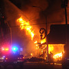 Globe/Roger Nomer<br /> Joplin firefighters try to extinguish a fire at 16th and Main Streets on Tuesday evening.