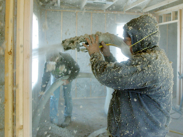 Globe/Roger Nomer<br /> Jesus Plascencia, wtih Boliver Insulation, spray insulation into the walls at 2630 Wall on Wednesday morning.