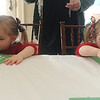 Globe/Roger Nomer<br /> Twin sisters Claire, left, and Elise Gould, 2, make handprint santas during Wednesday's holiday open house at the Ralph L. Gray Alumni Center at Missouri Southern.