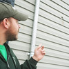 Globe/Roger Nomer<br /> Daniel Todd points out the hole in his siding at his house near 20th and Kentucky.