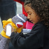 Globe/Roger Nomer<br /> Rhianna Carroll, 5, hugs her new MU sock monkey during Friday's Habitat dedication.