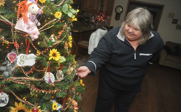"Globe/Roger Nomer<br /> Babs Tims talks about her ""Wizard of Oz"" tree, on her 35 Christmas trees on display this year."