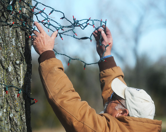 Globe/Roger Nomer<br /> Greg Taylor, with the Webb City Parks Department, strings Christmas lights at King Jack Park in Webb City on Tuesday morning.