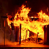 Globe/Joe Hadsall<br /> A fire emerges from a building at 16th and Main Streets on Tuesday evening. The building housed Bucklin's Furniture and used to be a May's Drug Store.