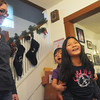 Globe/Roger Nomer<br /> The Franklin family, Lizanne, Gemma, 4, and Josie, 9, blend traditions in their household as shown by the stocking hungs on the staircase and the Chinese New Year decoration hanging on the doorway.