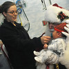 Globe/Roger Nomer<br /> Jessica Baker, Miami, preps her son Braiden Jarman, 9 days old, for his photo with Santa in the Freeman NICU on Thursday afternoon.  Children's Miracle Network Hospitals brought Santa to the Freeman NICU for photos and gave the babies gifts of a teddy bear, a book and a blanket.