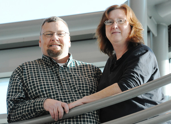 Terry Killman has battled leukemia for three years but will graduate this week from PSU. Here he stands in the Technology Center at PSU with his wife, Michelle Killman.<br /> Globe | T. Rob Brown