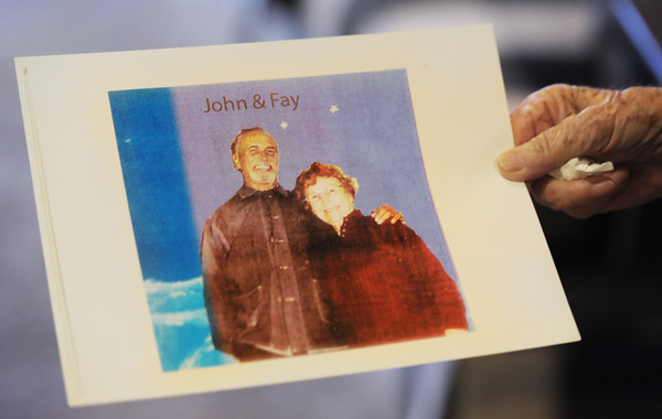 Fay Stephens holds a photo Thursday morning, Dec. 26, 2013, of her and her son, John, taken in prison.<br /> Globe | T. Rob Brown