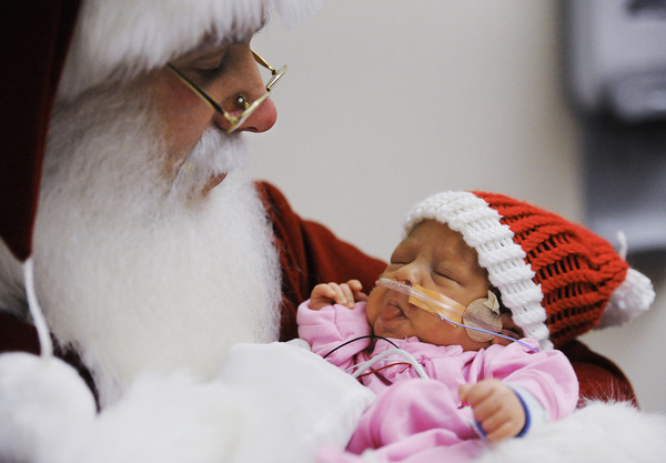 Santa Claus holds Kaleigh Baker of Joplin, born Nov. 14, in the NICU at Freeman West in Joplin on Monday morning, Dec. 23, 2013.<br /> Globe | T. Rob Brown