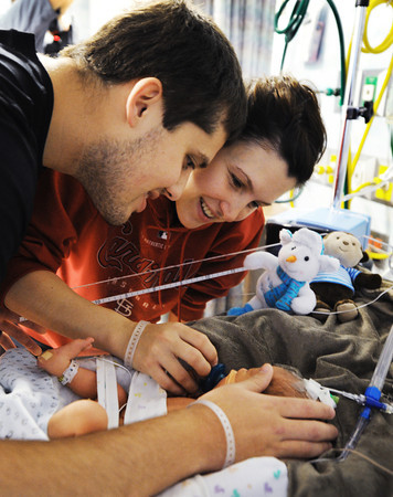 Seth and Ashley Wiehe visit their son Isaiah Wiehe, born Dec. 20 and currently in the NICU at Freeman West in Joplin on Monday morning, Dec. 23, 2013.<br /> Globe | T. Rob Brown