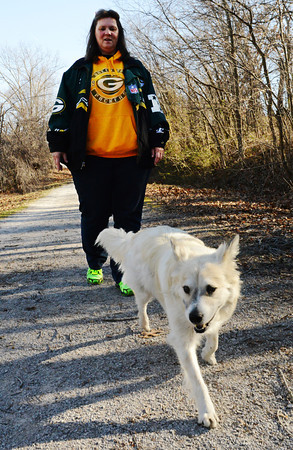 Kim Fowler of Carl Junction walks her dog Sam along the Frisco Trail near Royal Heights in Joplin.<br /> Globe | T. Rob Brown