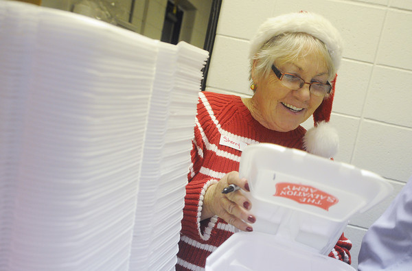 Globe/Roger Nomer<br /> Sherry Allen, Webb City, helps fill take-out orders at the Joplin Salvation Army on Wednesday.