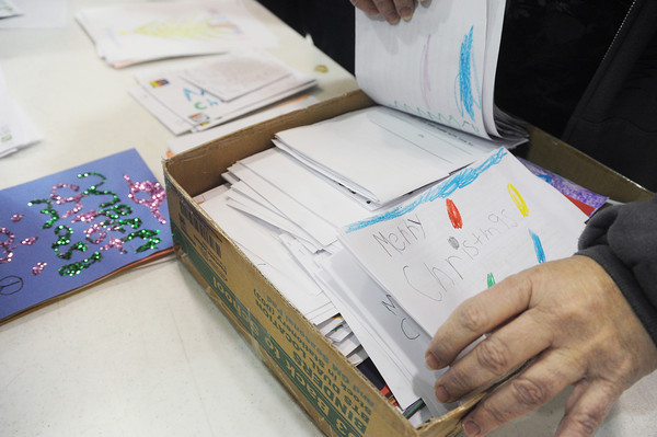 Globe/Roger Nomer<br /> Irving Elementary students created Christmas cards, about 900 in all, to be distributed at the Joplin Salvation Army's Christmas dinner on Wednesday.