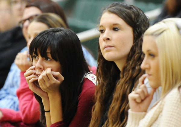 MSSU early childhood education majors (from left) Ryan Courier, Lindsey Sjorlund and Holly Kingore listen to instructions during a commencement rehearsal at Leggett & Platt Athletic Center Wednesday afternoon, Dec. 11, 2013.<br /> Globe | T. Rob Brown