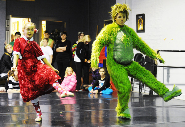 Joey Williams (right), 14, of Neosho, portrays the Grinch and Kailan Peters, 10, of Carl Junction, portrays Cindy Lou Who as they rehearse for the ballet version of The Grinch Monday evening, Dec. 2. 2013, at the Midwest Regional Ballet owned by Kaye Lewis, artistic director.<br /> Globe | T. Rob Brown
